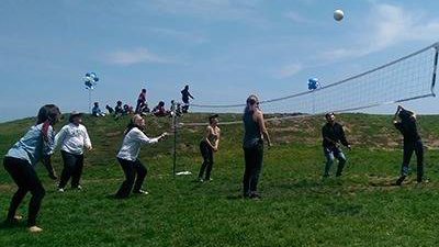 Photo of the PLOS team playing volley ball