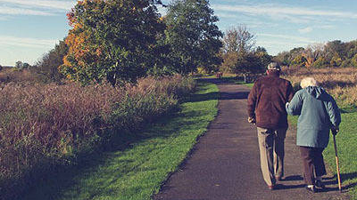 Photo of an elderly couple taking a walk